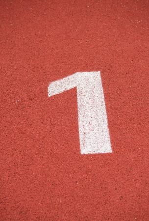 Number one on the start of a running track. Stock Photo - 17828616