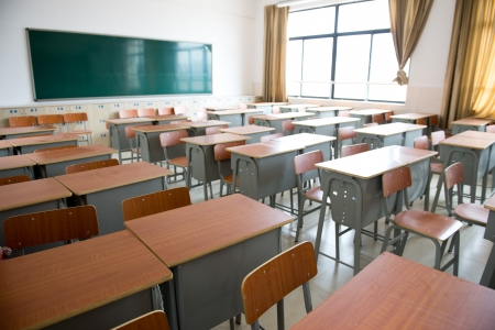 classroom training: Empty classroom with chairs, desks and chalkboard.