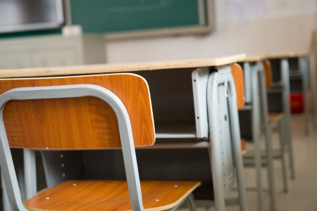 classroom training: Empty classroom with chairs and desks. Stock Photo