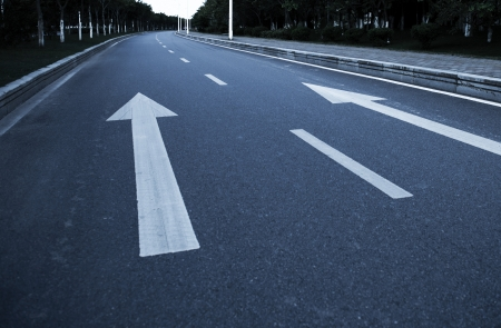Arrow on the road, concept of business vision, innovation and success. photo