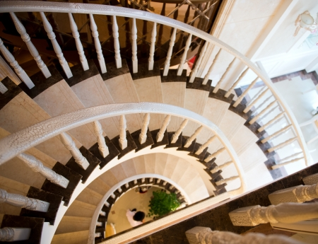 spiral staircase with wooden handrail. photo