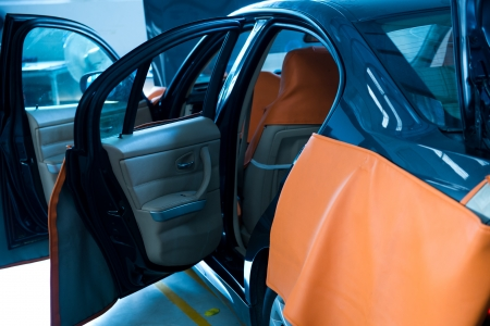open car door: Car in auto repair shop with open hood. Stock Photo