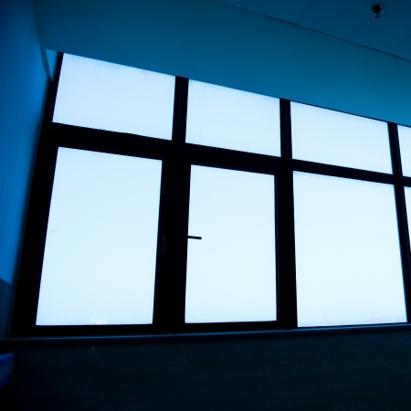 glass windows in a modern building. blue tone photo