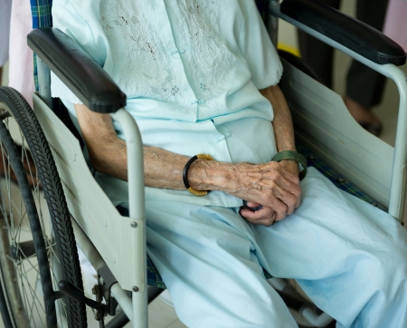 single person: old woman on a wheelchair.  Stock Photo