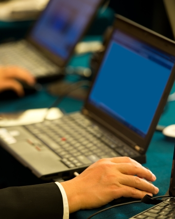Human hands typing on laptop keyboard. photo