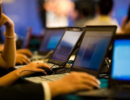 Human hands typing on laptop keyboard. Stock Photo - 18720098