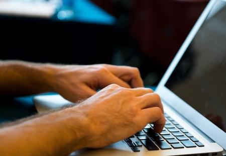 Human hands typing on laptop keyboard. Stock Photo - 18720934