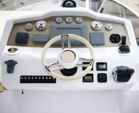 steering wheel on a luxury yacht cabin. photo