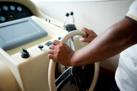 mastery: People at the helm of a luxury yacht. Stock Photo