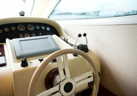 skipper: steering wheel on a luxury yacht cabin.