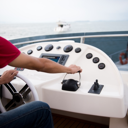 yacht people: People at the helm of a luxury yacht. Stock Photo