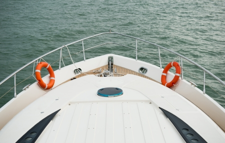 motor boats: Yacht is moving along the coast