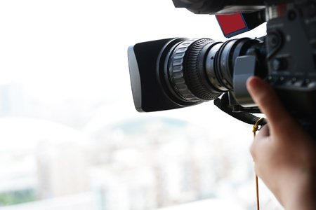 close up of television operator with camera. Stock Photo