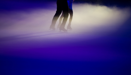 People ice figure skating with beautiful light effect. photo