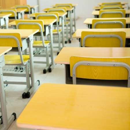 desk and chairs in classroom. photo