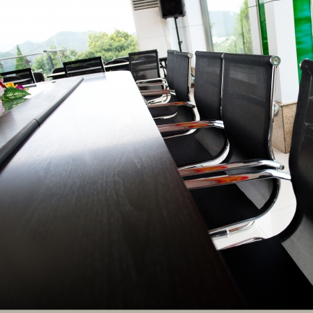 governance: Conference table and chairs in meeting room