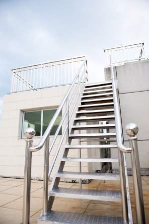 balustrade: New metal staircase on the top of modern building.