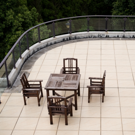 Apartment building roof top terrace exterior with table and chairs. photo