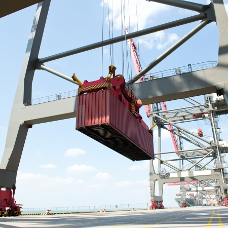 loading cargo: Container operation in the port. Stock Photo