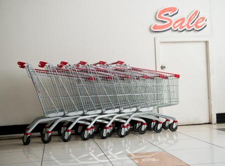Many empty shopping carts in a row. photo