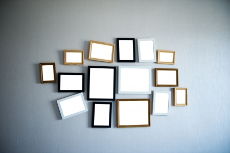 big picture: Group of picture frames on the wall.
