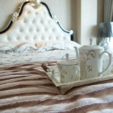duvet: luxury bedroom interior with beverage on bed.