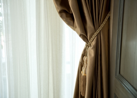 Composition of the elegant curtains against the wall. Stock Photo - 19279627