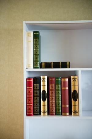 Many old books on the shelf. photo