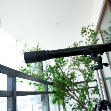 A telescope setting near the window. Stock Photo - 19278898