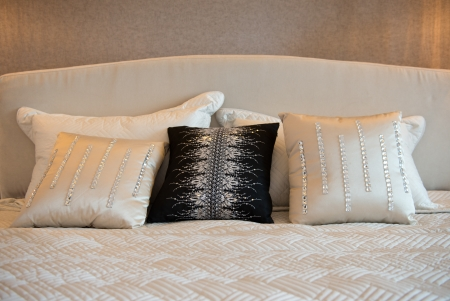 King sized bed in a business hotel room. Stock Photo - 19279626