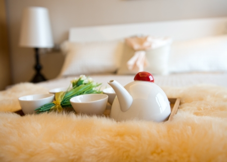 breakfast hotel: luxury bedroom interior with beverage on bed.