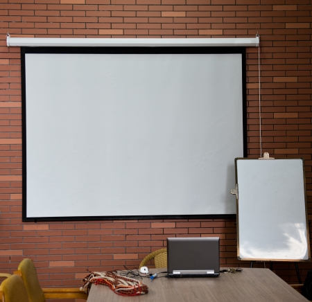 projection screen: Small whiteboard and projector screen.