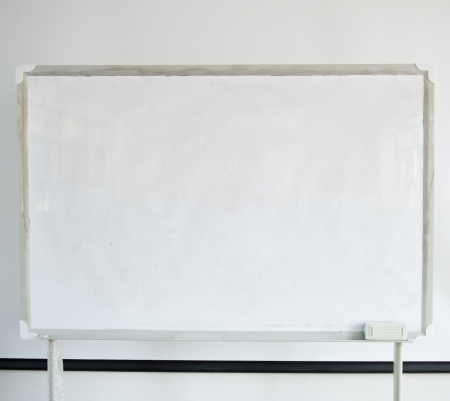Whiteboard and projector screen in a classroom. photo