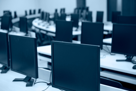 neatly: Group of computer neatly placed in a computer lab.