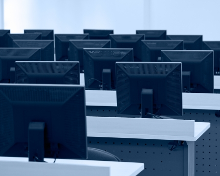 center table: Group of computer neatly placed in a computer lab.