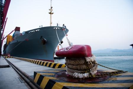 cargo vessel: Cargo ship in the harbor Stock Photo