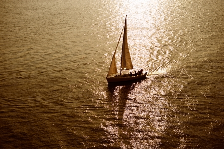 navigating: sailboat sailing sailing at the sea with a beautiful sunset.