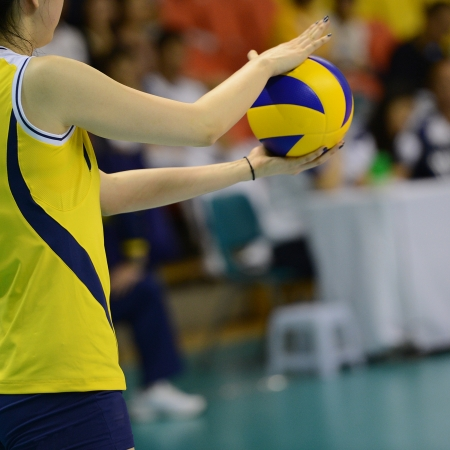 volleyball team: Volleyball player getting ready to serve.