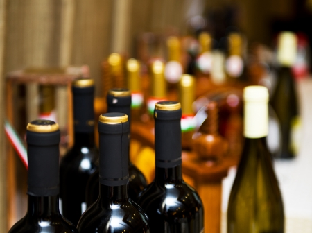 intoxicant: Bottles of wine shot with limited depth of field.