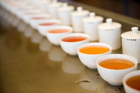 chinese tea pot: Cups Of Chinese tea in a row. Stock Photo