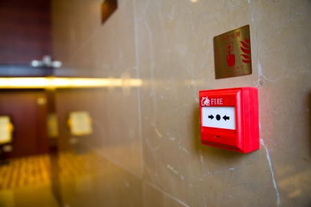 sprinkler alarm: fire alarm on the wall of hotel. Stock Photo