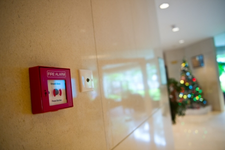 fire alarm on the wall of hotel. photo