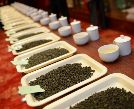chinese tea pot: Group of fresh green tea leaves and tea in a row.