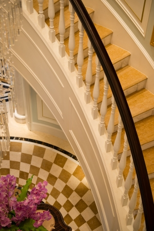 handrail: Interior luxury stairs with wooden railing. Stock Photo