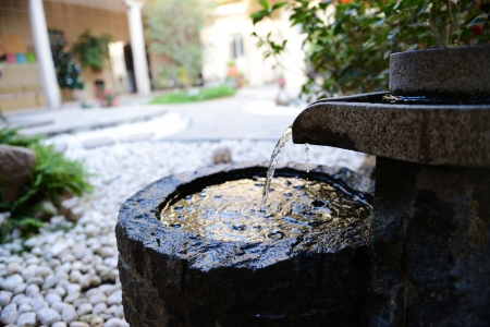 Traditional water fountain in garden
