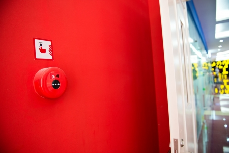 mounted: Fire alarm on the wall of shopping center. Stock Photo