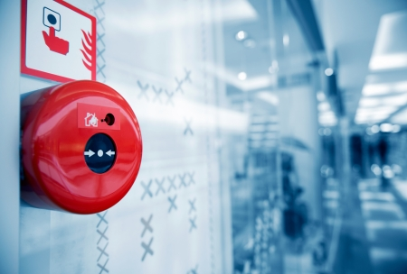 fire safety: Fire alarm on the wall of shopping center. Stock Photo