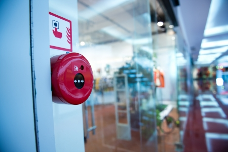 warning system: Fire alarm on the wall of shopping center. Stock Photo