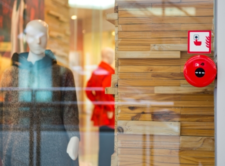 control centre: Fire alarm on the wall of shopping center. Stock Photo