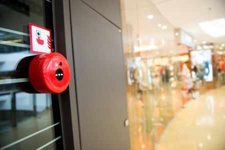 evacuation: Fire alarm on the wall of shopping center. Stock Photo